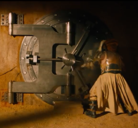 "Immortan Joe opens the bank vault door he uses to lock up his ""brides"" (read: women that he forcibly imprisons, sexually assaults, and impregnates so that he can have children)"